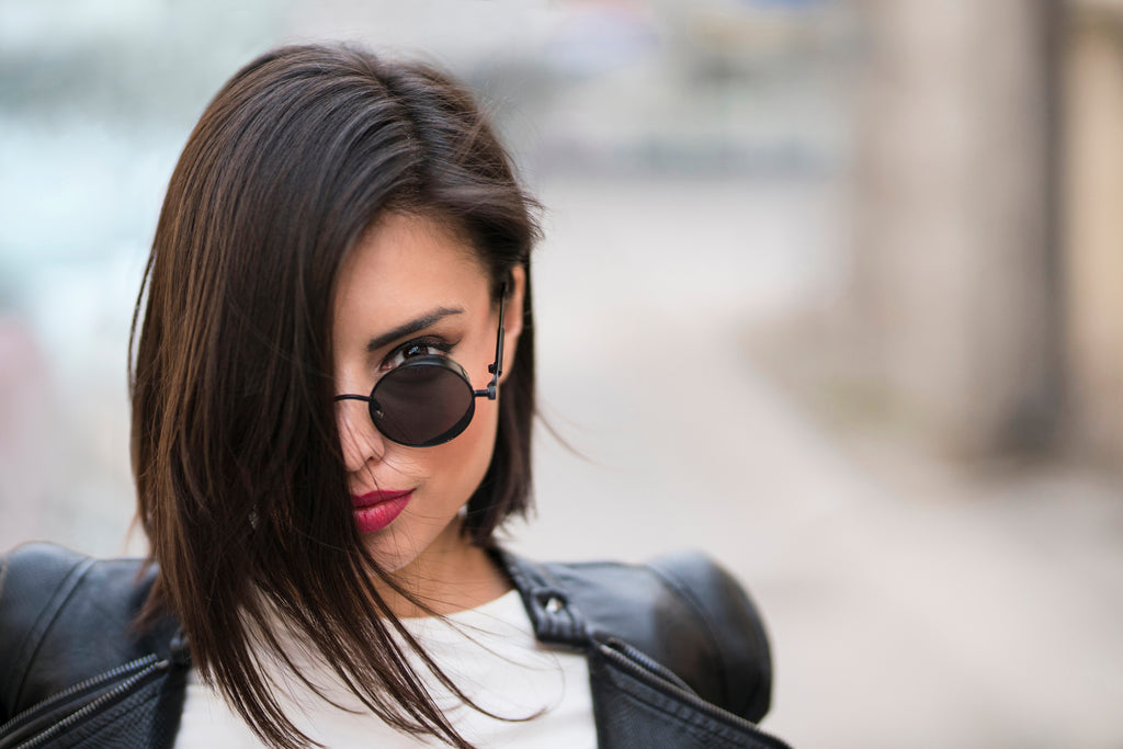 brunette looking fierce with sunglasses and a red lip