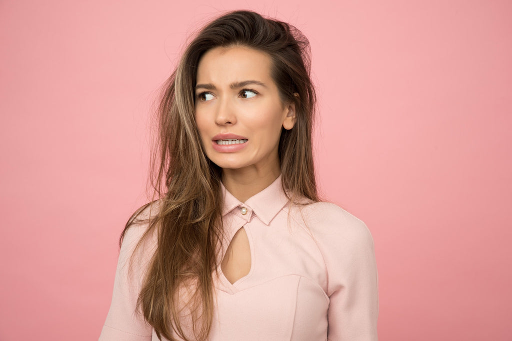 brunette in pink in front of pink background