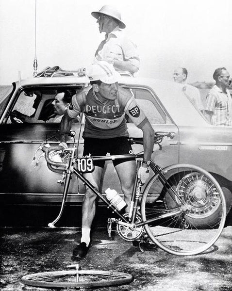 bicycle racer with flat tire