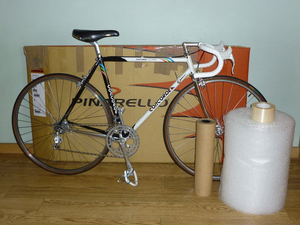 bike in front of box with packing materials