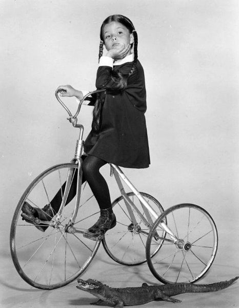 Wednesday Addams on tricycle
