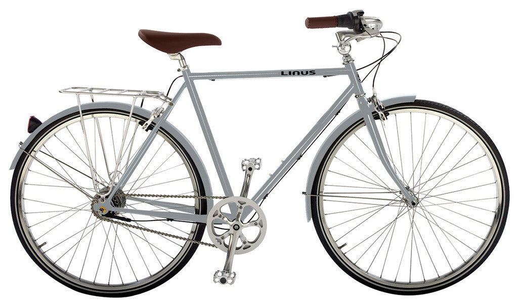 grey bike with brown saddle and grips