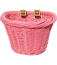 small pink wicker basket with brown straps