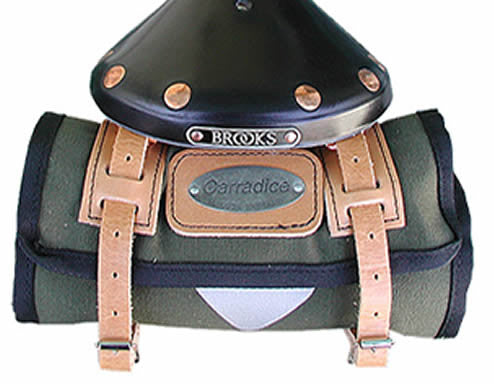 small olive green bag with tan straps shown on back of saddle