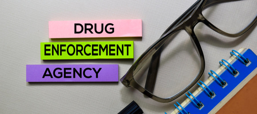 Drug Enforcement Agency with glasses and notepad