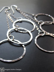 The Multiple Hammered Silver Rings On Chain Earrings