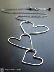 The Three Hanging Hammered Silver Hearts Necklace