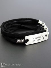 "The ""POWERED BY LOVE"" Hand Stamped Omnisex Silver And Eco Leather Wrap Bracelet"
