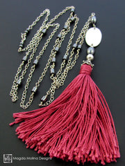 The Long Silver Chain Necklace With Red Silk Tassel And Hematite Accent
