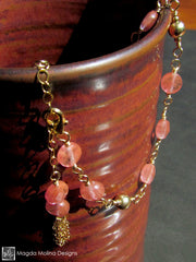 The Delicate Cherry Quartz Bracelet With Golden Tassel