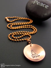 The Hand Stamped Copper Buddha And Peace Necklace