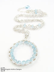 The Infinity Circle Hammered Silver Necklace With Blue Topaz Gemstones