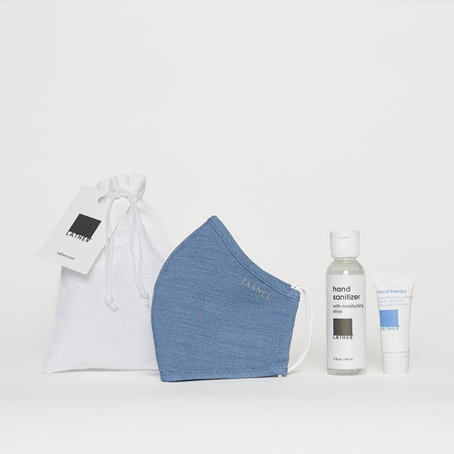 Conscious care kit includes a light blue mask made by Jaanuu, a 2 ounce bottle of LATHER hand sanitizer, and a half ounce tube of LATHER Hand Therapy. These all come in a small white fabric pouch for easy carry.