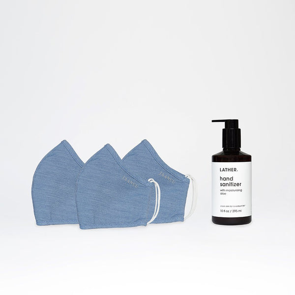 The LATHER Got You Covered Kit includes three light blue Jaanuu masks and one bottle of the LATHER 10 ounce hand sanitizer
