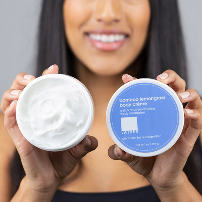 women holding Bamboo Lemongrass Body Crème to show texture