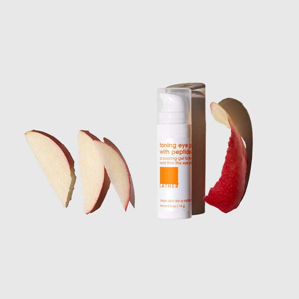 Toning Eye Gel with Peptides surrounded by slices of apple