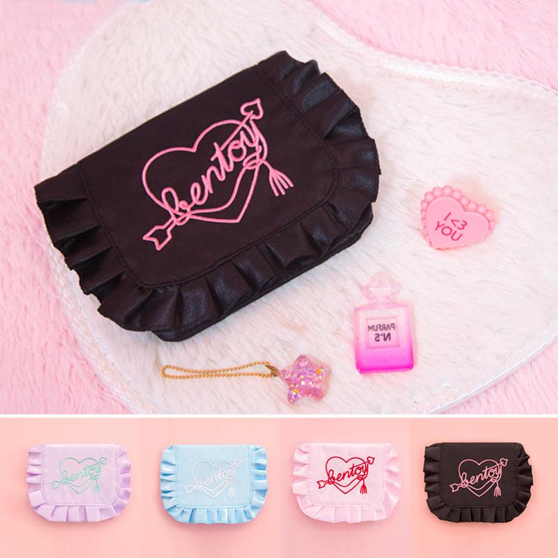 The embroidered tampon storage bag is originally made by neon moon