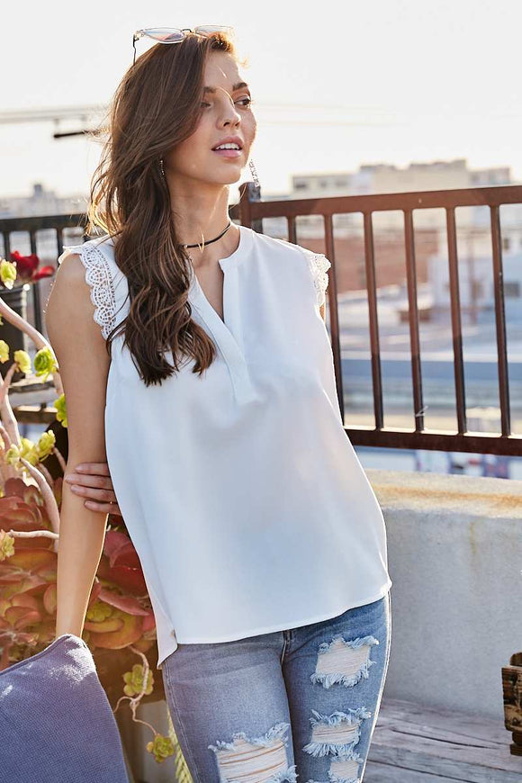 Notched Neck Trim Sleeveless Solid Top.