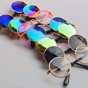 Coolest shades for your coolest pet. Variety of colors of  doll looking pet sunglasses that will make any dog look and feel great