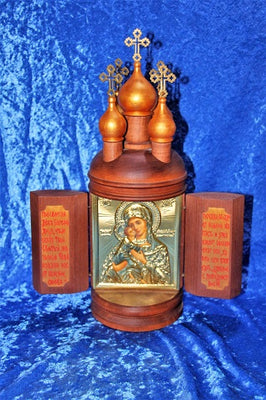 Icon in wooden case with doors and cupolas