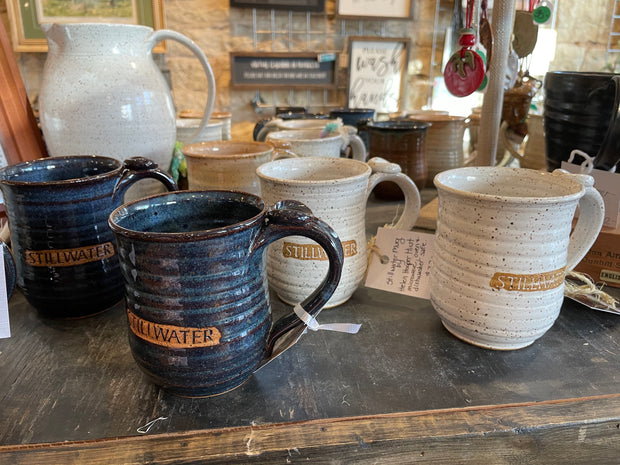Specialty Stillwater Mugs with thumbprint on handle: blue or white