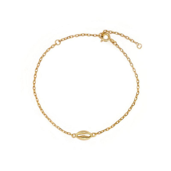 Simple and elegant Cowrie Shell Bracelet in 18K gold vermeil by Ma Petite Mer Jewelry