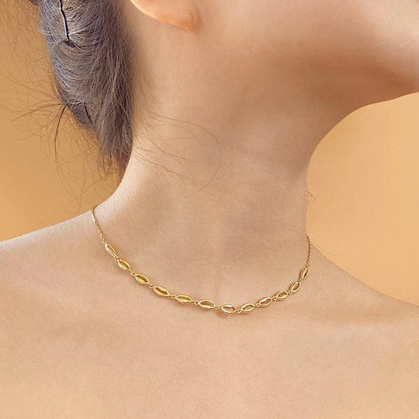 Simple yet elegant Cowrie Shell Choker Necklace in 18K Gold Vermeil by Ma Petite Mer Jewelry