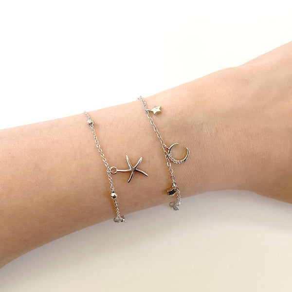 Layered sterling silver bracelets by Ma Petite Mer Jewelry