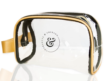 Clear cosmetic bag with gold and black trim