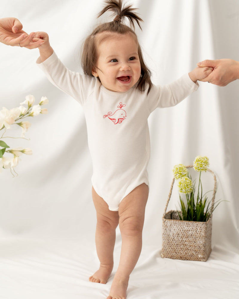 Organic cotton long sleeve baby bodysuit. Made from 100% Certified Organic Cotton. Undyed nature white color. Safe for sensitive skin.