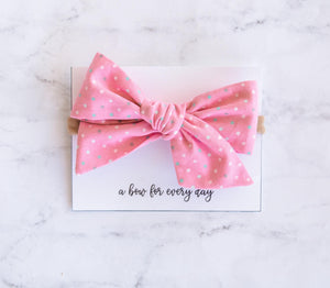Pink polka dot sailor bow