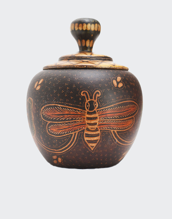 "his image shows a magnificent ""apple shaped"" Batik Butterfly Jewelry Container that is made of hand carved wood. The container is carved and painted by a highly skilled artisan in Indonesia and is the highest quality example of this type of art. The central motif is two beautifully dye painted butterflies. The container will enhance any living room décor, bedroom décor, kitchen décor, hallway. décor or office décor."