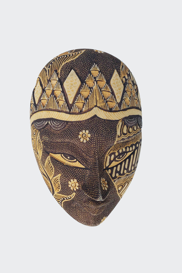 "This image shows the magnificent Wajah jewelry container crafted from carved soft albesia wood with painstakingly hand dye-painted multi-colored Batik motif. The mask is carved and painted by a highly skilled artisan in Indonesia. The lid of the box is a ""Wajah"" or ""face"". The lid is lifted to reveal the compartment inside suitable for storing jewelry or small items. The container will enhance any living room decor, bedroom decor, kitchen decor, hallway. decor or office decor."