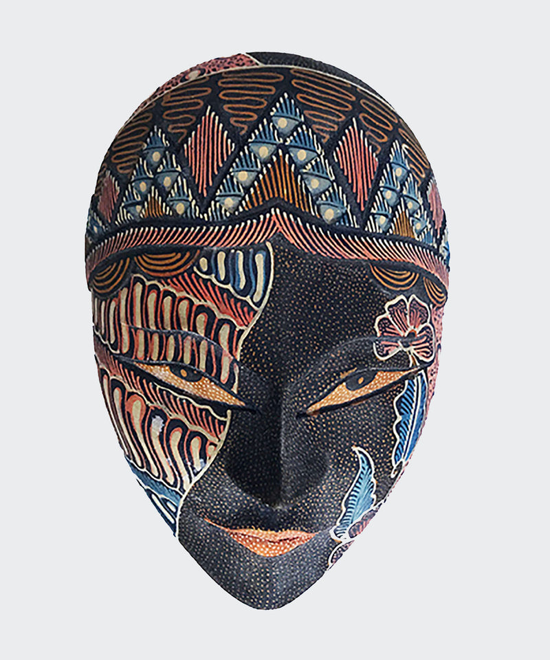 "This image shows the magnificent Wajah jewelry container crafted from carved soft albesia wood with painstakingly hand dye-painted multi-colored Batik motif. The mask is carved and painted by a highly skilled artisan in Indonesia. The lid of the box is a ""Wajah"" or ""face"". The lid is lifted to reveal the compartment inside suitable for storing jewelry or small items. The container will enhance any The mask will enhance any living room decor, bedroom decor, kitchen decor, hallway decor or office decor."
