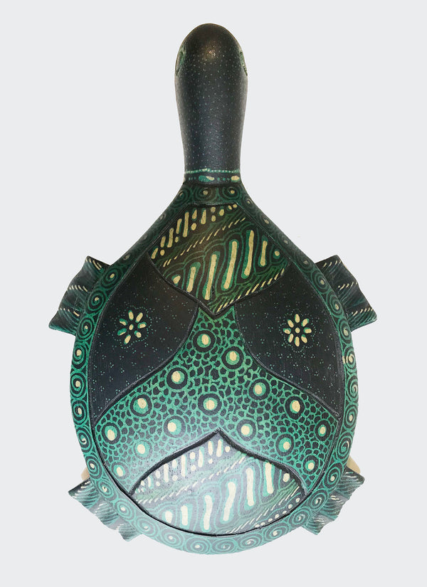 "This image shows the back of the magnificent Kura Kura (turtle) 'Batik Hand Mirror crafted from carved wood with painstakingly hand dye-painted multi-colored Batik motif. The hand mirror is carved and painted by a highly skilled artisan in Indonesia. The back of the hand mirror is a ""Wajah"" or ""face"". The Batik Hand Mirror will enhance any living room decor, bedroom decor, kitchen decor, hallway decor or office decor."