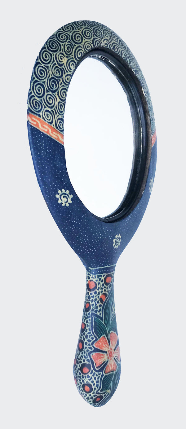 his image shows the magnificent Wajah Batik Hand Mirror with an angle side view.