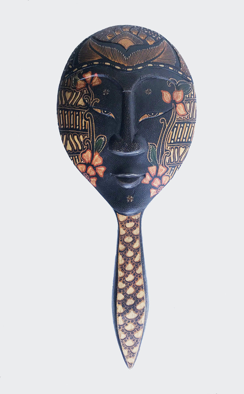 "This image shows the back of the magnificent Wajah (Face) Batik Hand Mirror crafted from carved wood with painstakingly hand dye-painted multi-colored Batik motif. The hand mirror is carved and painted by a highly skilled artisan in Indonesia. The back of the hand mirror is a ""Wajah"" or ""face"". The Batik Hand Mirror will enhance any The mask will enhance any living room decor, bedroom decor, kitchen decor, hallway decor or office decor."