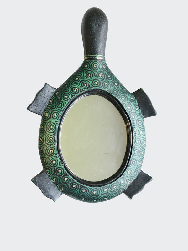 This image shows the magnificent Kura Kura (turtle) 'Batik Hand Mirror with an angle side view.
