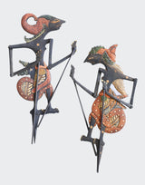 This image shows a srt of two ornamental Shadow Puppets Wayang Kayu (wooden puppet) and are entirely hand made by skilled Artisans in Java Indonesia. The bodies of the puppets are made of intricately carved albesia wood painted in beautiful Batik art designs. The arms and manipulating rods are fully functional. The Puppets will greatly enhance any living room decor, bedroom decor, kitchen decor, hallway. decor or office decor.