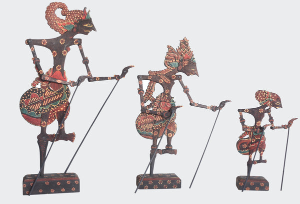 This image shows three ornamental Shadow Puppets Batik Wayang Kayu, Nakula, Rama and Yudistira in stands.