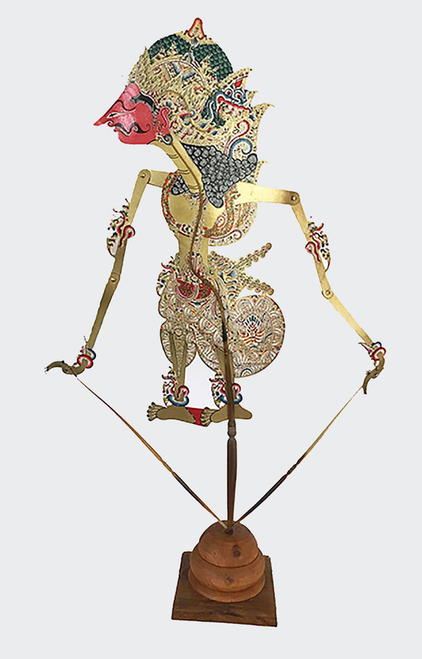 This image shows the actual FULL-SIZE Shadow Puppet manipulated by the Dalang (puppet master) of the Indonesian shadow theatre play. The body of the puppet is made of intricately carved and colorfully painted water-buffalo leather. The Puppet is carved and painted by a highly skilled artisan in Indonesia. The center handle and manipulating rods are carved from the water buffalo horn. The Puppet will greatly enhance any living room decor, bedroom decor, kitchen decor, hallway. decor or office decor.
