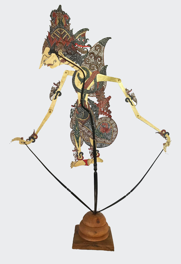 This image shows the actual FULL-SIZE Shadow Puppet manipulated by the Dalang (puppet master) of the Indonesian shadow theatre play. The body of the puppet is made of intricately carved and colorfully painted water-buffalo leather. The Puppet is carved and painted by a highly skilled artisan in Indonesia. The center handle and manipulating rods are carved from the water buffalo horn. The Puppet will greatly enhance any iving room decor, bedroom decor, kitchen decor, hallway. decor or office decor.