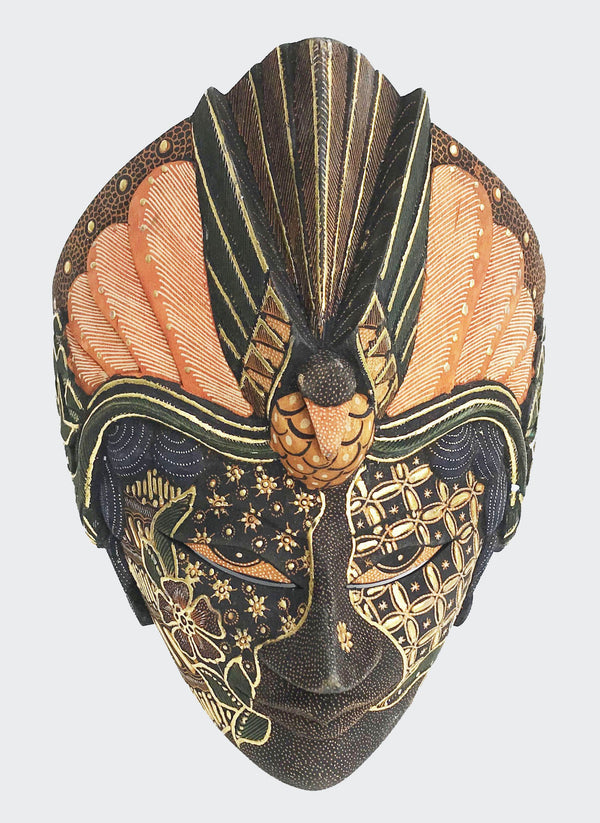 "This image shows a magnificent Wall Decor Topeng Mask in hand carved wood with intricately hand dye-painted and colorful Indonesian Batik motif and inlaid with gold (prada). Topeng means mask or dance mask and mask-theater. The mask is carved and painted by a highly skilled artisan in Indonesia. The mask depicts a Peacock or Merak in the Indonesian language ""Bahasa"". The mask will enhance any living room decor, bedroom decor, kitchen decor, hallway. decor or office decor."