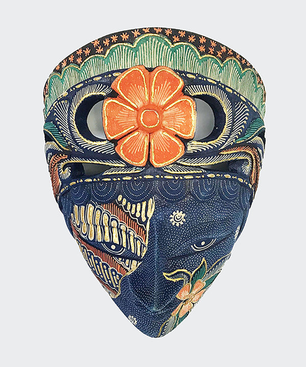 This magnificent Wall Decor is a mask of a girl with a flower crown. The mask is made of hand carved wood with intricately hand dye-painted and colorful Batik motif and inlaid with gold (prada). The mask has a variety of designs and the flower may be Orange or dark brown. The mask will enhance any living room decor, bedroom decor, kitchen decor, hallway decor or office decor.