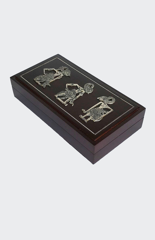This image shows an elegant rectangular Wayang Art Jewelry Box made of resin-impregnated wood with intricately patterned Wayang motif in Pewter on the lid of the box. The lid is lifted to reveal the compartment inside which has a soft fabric base suitable for small items such as Lady's jewelry or Men's cuff links etc. The container set will enhance any living room decor, bedroom decor, kitchen decor, hallway. decor or office decor.