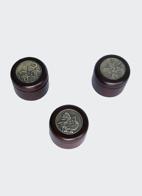 This image shows an elegant Jewelry or Trinket Set of three Containers is made of resin-impregnated wood with intricately patterned Wayang Shadow Puppet motif in Pewter on the lid of the container. The container set will enhance any living room décor, bedroom décor, kitchen décor, hallway. décor or office décor