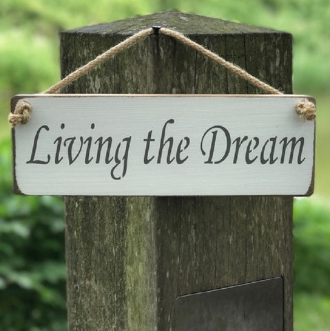 Handmade British wood Living the Dream white sign