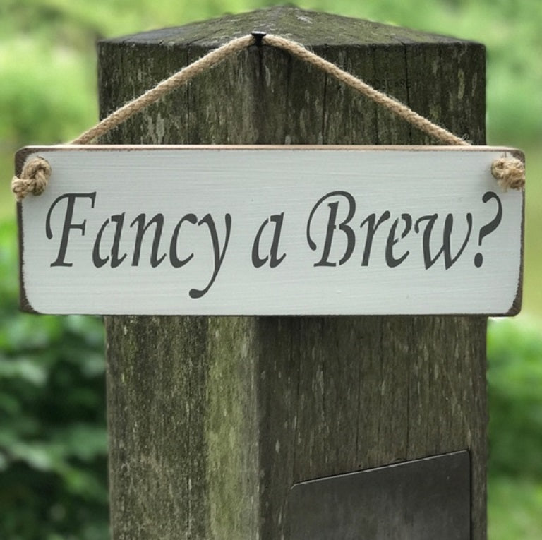 Handmade British wood Fancy a Brew white sign