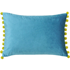 Teal velvet cushion with bamboo coloured Pom Poms