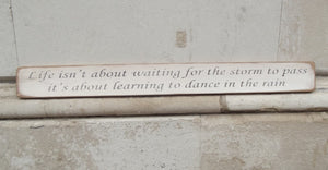'Life isn't about waiting for the storm to pass...' Handmade Wooden Sign